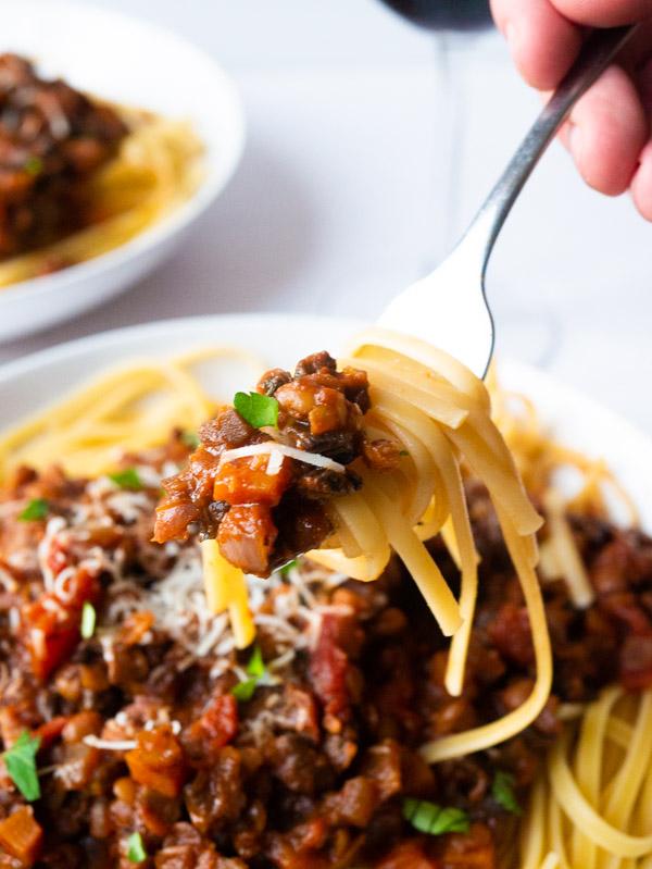 Mushroom and Lentil Spaghetti Bolognese on a fork
