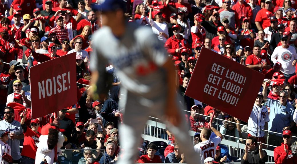 WASHINGTON, DC - OCTOBER 9: Fans cheer while Rich Hill #44 of the Los Angeles Dodgers works against the Washington Nationals in the second inning during game two of the National League Division Series at Nationals Park on October 9, 2016 in Washington, DC. (Photo by Patrick Smith/Getty Images)