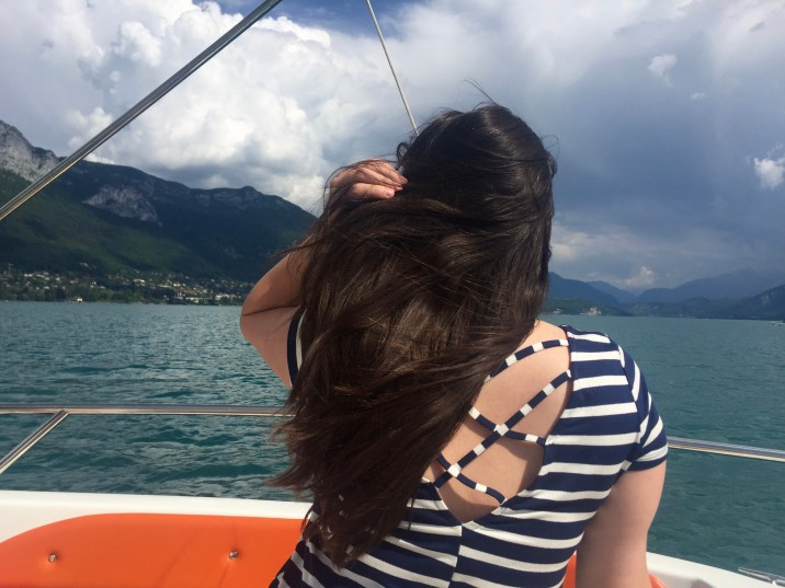 Taking a boat ride around the Annecy Lake