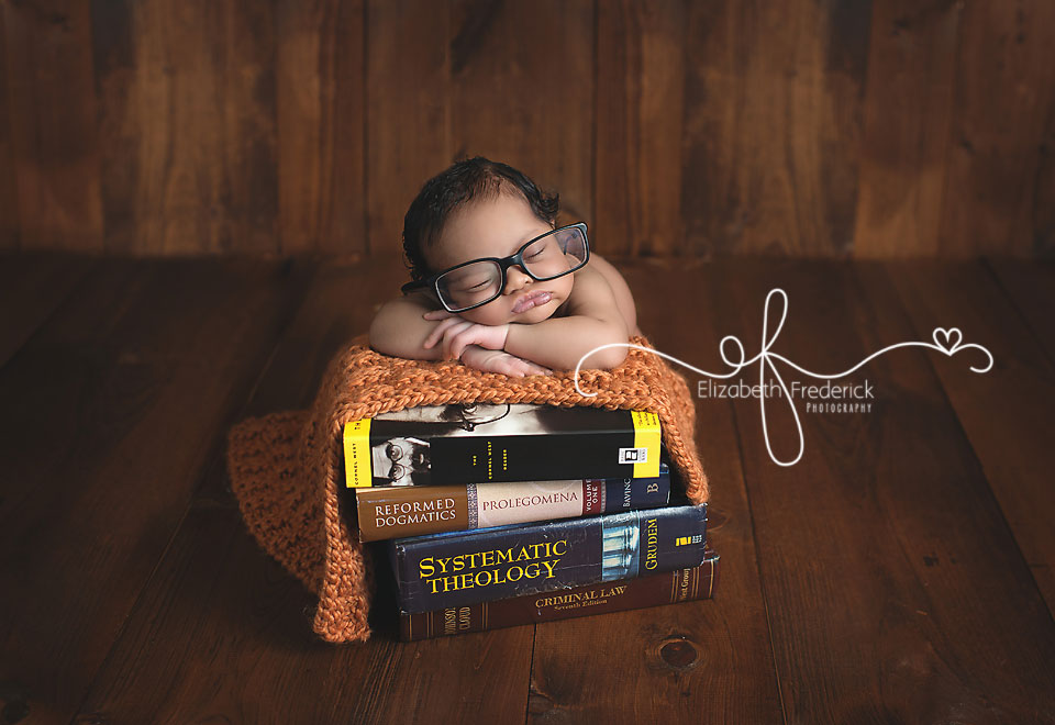 Ct newborn photographer elizabeth frederick photography newborn boy laying on books with reading glasses