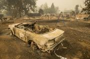 A vehicle and swing were scorched by the Valley Fire line in Middletown.
