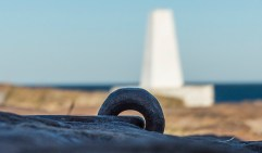 This metal ring set into the stone is not in the novel, but I like this shot with the old trig point in the background.