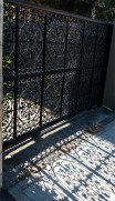 Wrought metal gates casting shadows.