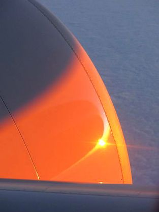 Sunrise: the fuselage and the rising sun are reflected in the engine cowling.