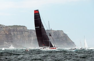 Comanche, an American entrant, is first past North Head.