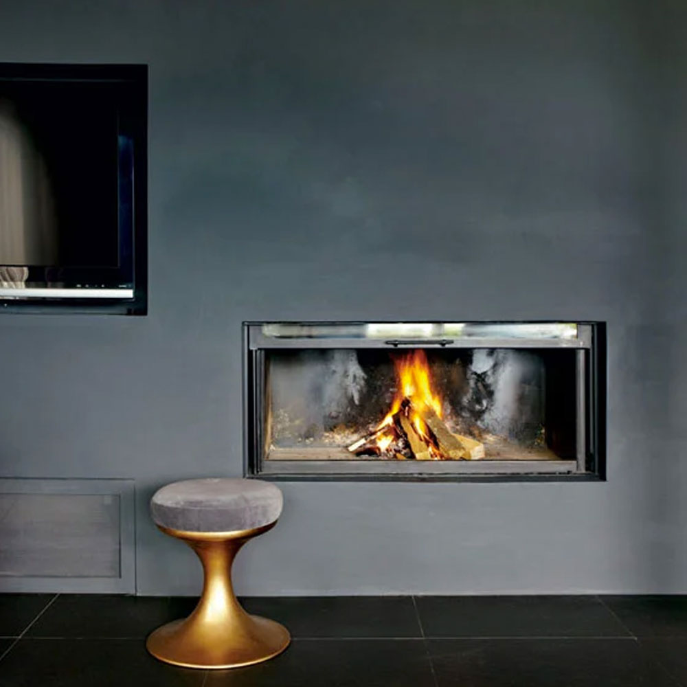 a fireplace with black wallpaper