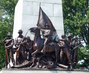 A close-up of the soldiers at the base of the statue of General Lee.