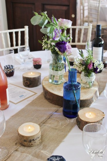 Rustic centrepiece with bottle and jam jars- Elizabeth Weddings