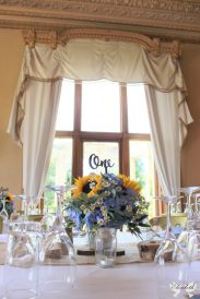 Blue and yellow floral centrepiece- Elizabeth Weddings