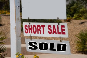 short sale and sold real estate sign
