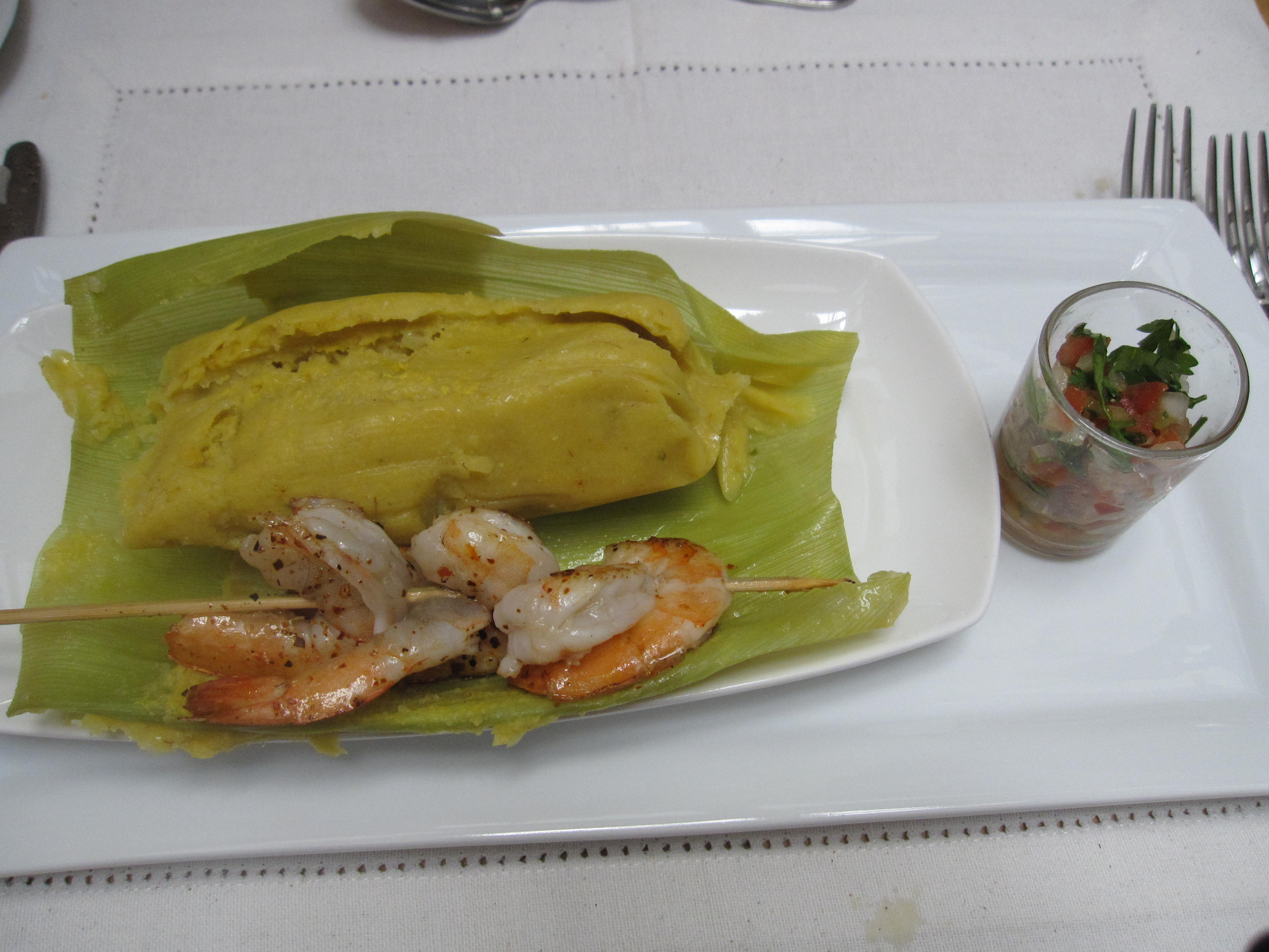 Traditional humitas, similar to a tamale and made with fresh corn, onion, basil and butter and served here with sauteed shrimp; Chef Pilar Rodriguez, Santiago