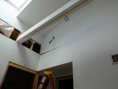 Right through our pristine kitchen walls.