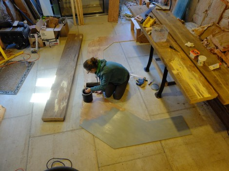 We started by laying a plywood floor underneath the footprint of the bar - to bring the floor to the same height as our (yet-to-be) tiled floor.