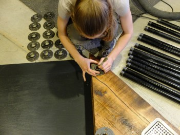 Spoting the holes for the flanges - these marks will get translated through both shelves to hit marks on the floor. Perfectly, of course.