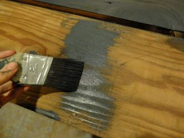 Brush onto a small area of the wood.