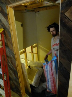This crazy man off the streets helped me insulate the bathrooms! ;)
