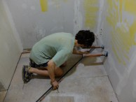Drawing the initial grid lines in the bathroom.