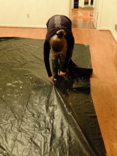 Creating the plastic strips from a tarp.
