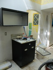 """Both cabinets are painted our theme color - """"Evening Hush."""" The upper cabinet is spray-painted silver on the inside. It has a glass door that retracts into the top."""