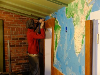 Stitching together a new version of Central America above the window! No one will ever know... except you!