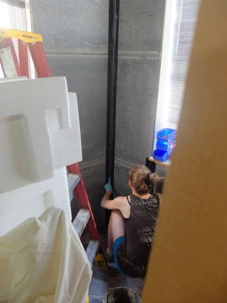 Grouting in the seams of the walls.