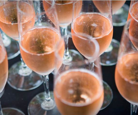 pink sparkling wine in flute glasses