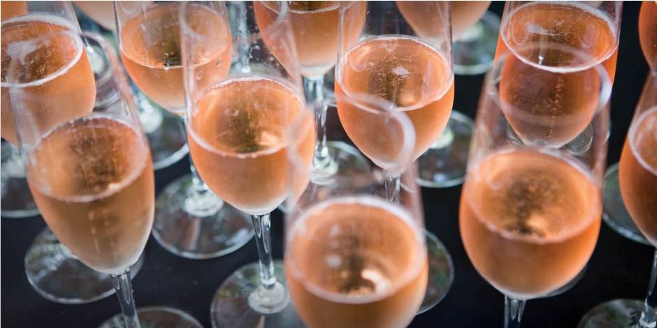 pink sparkling wine in flute glasses