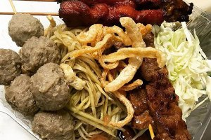 SEA Hut Platter with Chicken, Beef, Pork, Meatballs, and Papaya Salad