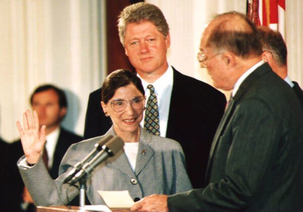 Chief Justice of the U.S. Supreme Court William Rehnquist (R) administers the oath of office to newly-appointed U.S. Supreme Court Justice Ruth Bader Ginsburg (L) as U.S. President Bill Clinton looks on 10 August 1993. Ginsburg is the 107th Supreme Court justice and the second woman to serve on the high court.