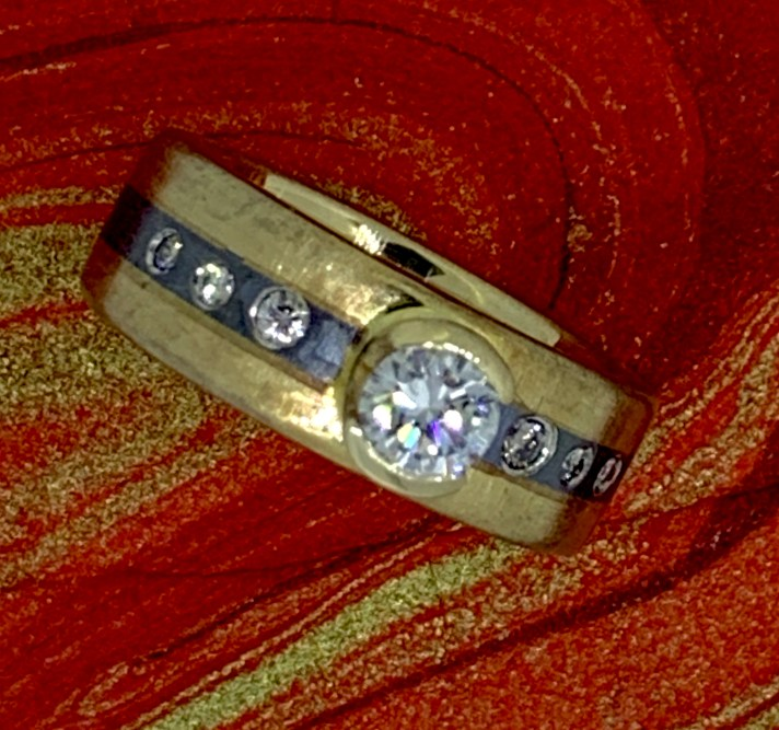 Half carat diamond ring, (VS 2, G/H, Excellent cut) 14k gold, oxidized sterling center band, set with 6 diamonds.