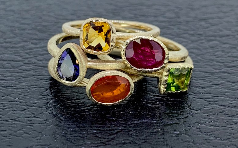 14k gold, from top: Antique cut citrine, oval ruby, pear iolite, square peridot, oval Mexican fire opal