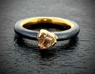 Natural Oregon Sunstone, 22k gold inner band, 14k setting, oxidized sterling silver. Size 7+