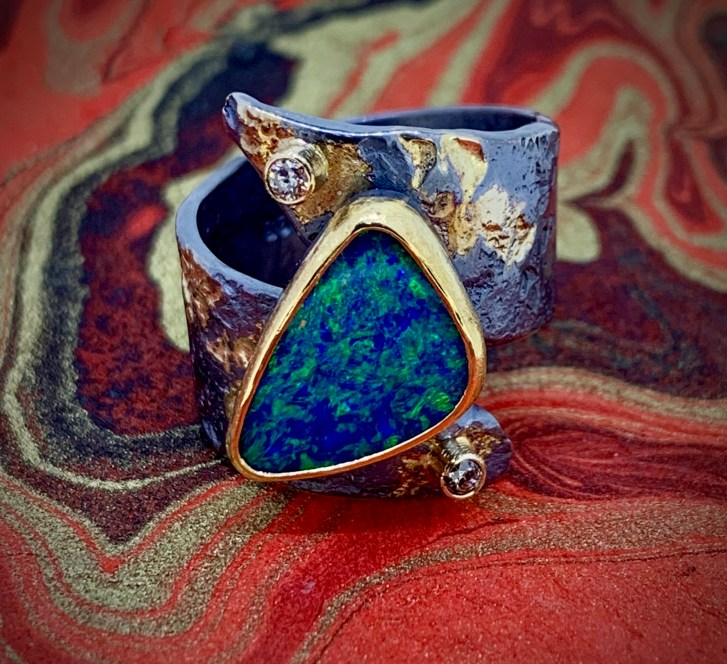 Boulder opal in 22k gold with diamonds and oxidized sterling with 14k gold