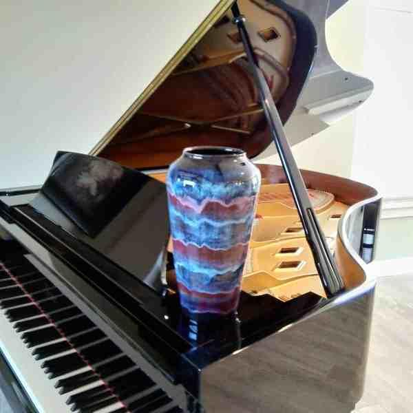 Large ceramic vase on piano