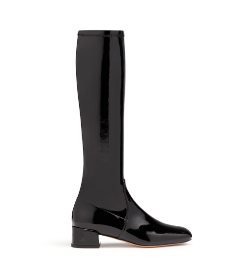 """""""Living in a city, it's easy to spend money on shoes that after a day's worth of wear get completely destroyed. These patent leather boots solve that problem. They're easy to clean (snow salt—be gone!), have a PERFECT little heel, and, for those of you who are brave, come in white. Chic."""" Stuart Weitzman 'Poppy' Boot, $485; stuartweitzman.com"""