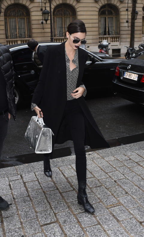 Carrying a silver Dior 'Diorever' bag at Paris Fashion Week.