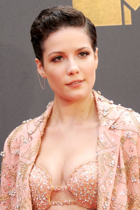 Halsey gelled her short hair skyward for a modern take on the '60s  greaser look.