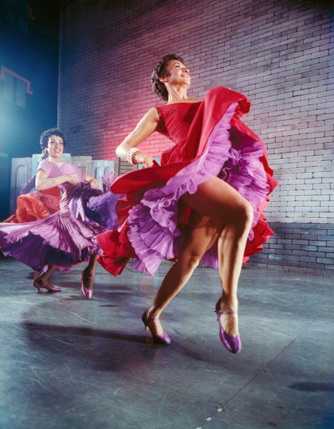 Chita Rivera performed in the Broadway production of West Side Story wearing this vibrant red dress with lilac tulle ruffles underneath.