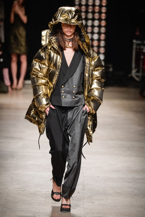 As an avid Patagonia fan, I am thrilled to announce that puffer jackets are finally cool. But more than just down feathers and high-tech insulation, this season's styles vary from flashy (like this metallic number from Vivenne Westwood) to feathery. Top an LBD with a puffer jacket for a chic but cozy night out.