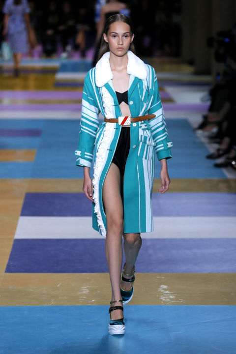 Who needs a crochet coverup when you can imitate a Miu Miu model? They layered retro bikinis with belted coats in an advanced class of beach-to-brunch dressing. That's a thing, right?