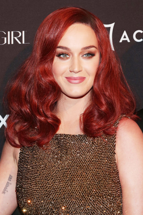 Go full Jessica Rabbit with Katy Perry's bright reddish-burgundy.