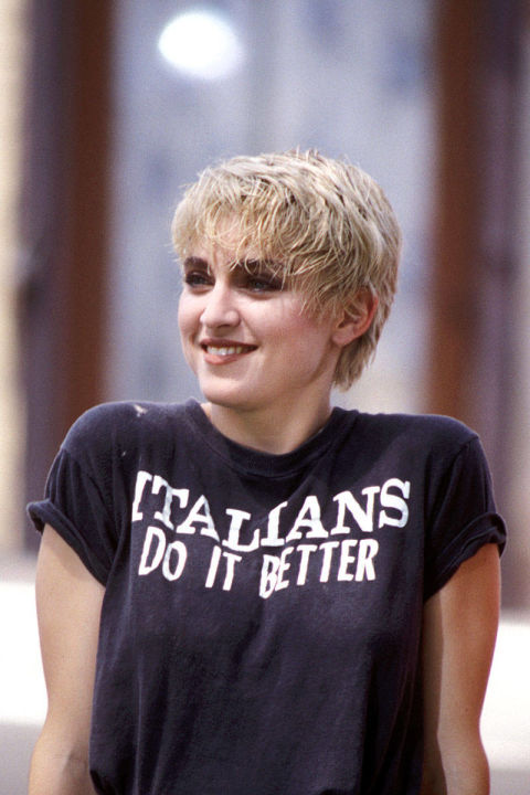 Italians do it better? Why, yes, Miss Ciccone! You've been doing your part to prove that over the years, especially with your ever-changing hairstyles, like this bleached boyish pixie cut.