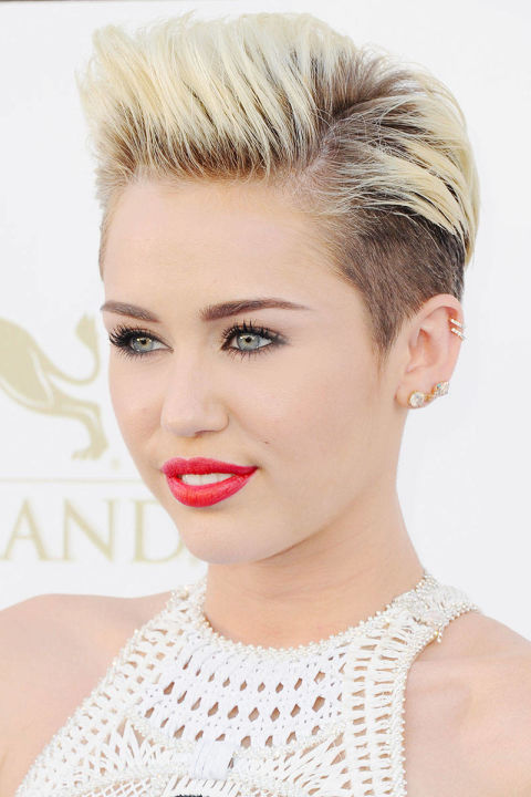 """Tick tock tick tock,"" Cyrus wrote to her Twitter fans, only a short time before posting a photo of hairstylist Chris McMillan about to chop off her girl-next-door locks. The big reveal was a drastic bleached pixie cut with shaved sides and long bangs that sent the social space into a frenzy. But the singer stood by her look. ""Never felt more me in my whole life,"" she wrote in response, and proceeded to win over her naysayers by showing them just how gorgeous gutsy can be."