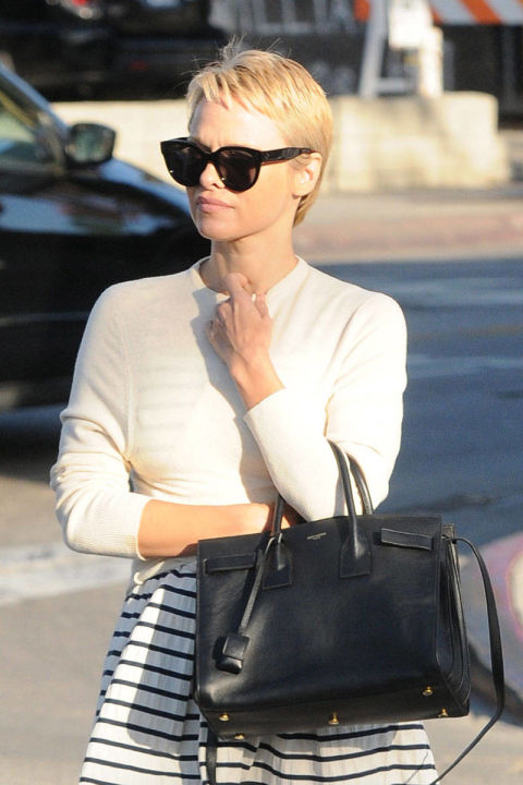 Pamela Anderson may have been America's blonde bombshell in the nineties, frolicking on the beach as her long hair whipped through the wind, but this shorter style suits her.