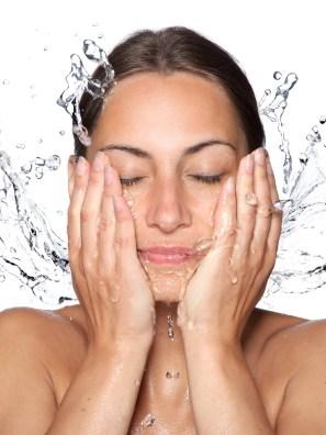 person washing face damp skin