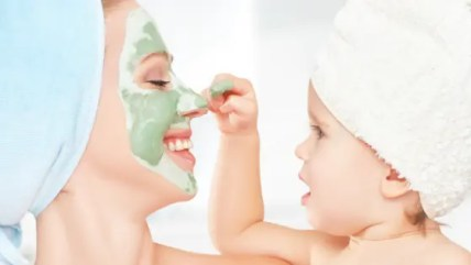 parent and child playing with skincare mask