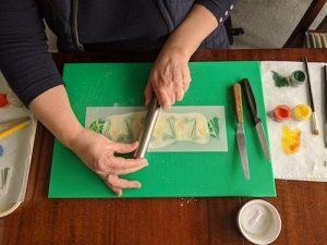 Position your stencil – when in position lightly roll the stencil onto the paste so that it stays in place and all the fine details of the stencil are lightly sticking to the paste.