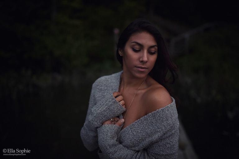 Photographer Ella Sophie. Sensual outdoor boudoir at dusk, woman in open sweater.