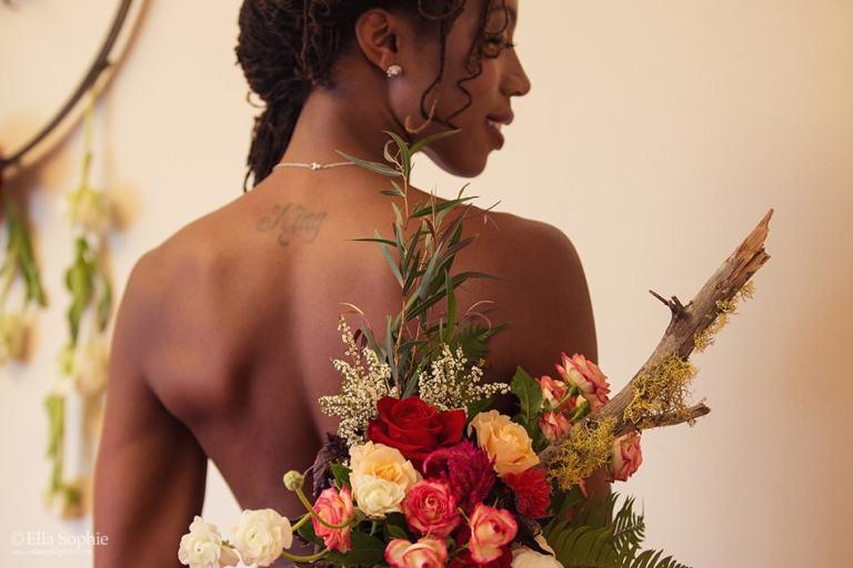 close up flower bouquet bridal boudoir photo, black woman. by Oakland Photographer Ella Sophie