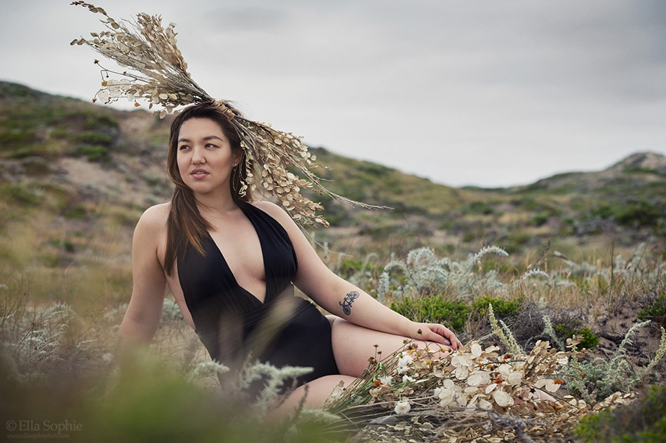 Confident natural woman in black bodysuit with flower crown, fine art Photographer Ella Sophie